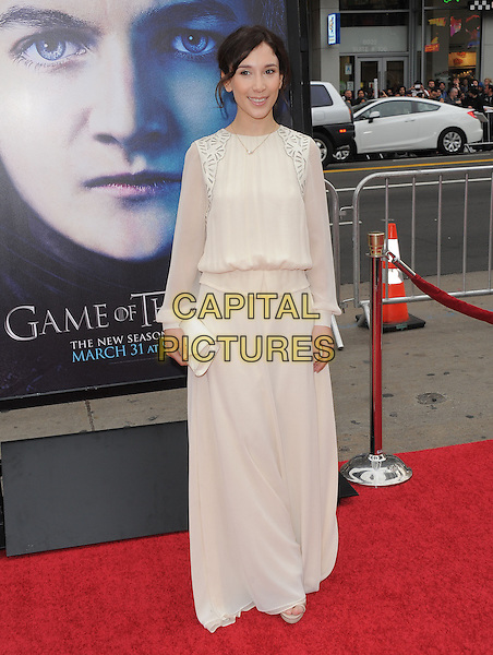"Sibel Kekilli.""Game Of Thrones"" 3rd Season Los Angeles Premiere held at the TCL Chinese Theatre, Hollywood, California, USA..March 18th, 2013.full length dress cream clutch bag maxi sheer sleeves white.CAP/RKE/DVS.©DVS/RockinExposures/Capital Pictures."