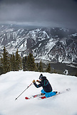 USA, Colorado, Aspen, telemark skier makes turns at the top of Kessler's run, Aspen Highlands Ski Resort