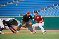 Jac Caglianone (17) of Plant High School in Tampa, FL waits for a pitch off attempt throw as Joshua Baez (16) dives back to the bag during the Perfect Game National Showcase at Hoover Metropolitan Stadium on June 17, 2020 in Hoover, Alabama. (Mike Janes/Four Seam Images)