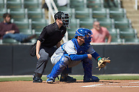 Lexington Legends catcher Freddy Fermin (4) sets a target as home plate umpire Jose Lozada looks on during the game against the Kannapolis Intimidators at Kannapolis Intimidators Stadium on May 15, 2019 in Kannapolis, North Carolina. The Legends defeated the Intimidators 4-2. (Brian Westerholt/Four Seam Images)