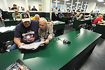 (Boston Ma 06/06/15) Mike Tecce, 52, and his father Sal, 80, both of Everett, look over the racing form for the Belmont Stakes,  Saturday, June 6, 2015, at Suffolk Downs in Boston. Herald Photo by Jim Michaud
