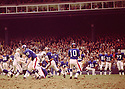 New York Giants Greg Larson (53) blocks for Fran Tarkenton (10) during a game agains the Baltimore Colts on November 3,1968 at Yankee Stadium in the Bronx, New York.  The  Baltimore Colts beat the New York Giants 26-0. Greg Larson played for 13 years, all with the New York Giants and was a 1-tim Pro Bowler(SportPics)