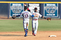 Scottsdale Scorpions infielders Shed Long (6) and Andres Gimenez (13) celebrate a victory after an Arizona Fall League game against the Peoria Javelinas at Peoria Sports Complex on October 18, 2018 in Peoria, Arizona. Scottsdale defeated Peoria 8-0. (Zachary Lucy/Four Seam Images)