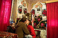 ROMANIA / Maramures / Breb / 03.09.2006 ..Ancutsa, 17, with her boyfriend, Liviu, 18, who is from the neighboring village of Budesti. It is customary for young men to visit with women in the evenings. ..© Davin Ellicson / Anzenberger
