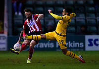 Lincoln City's Neal Eardley clears under pressure from Milton Keynes Dons' Louis Thompson<br /> <br /> Photographer Andrew Vaughan/CameraSport<br /> <br /> The EFL Sky Bet League One - Lincoln City v Milton Keynes Dons - Tuesday 11th February 2020 - LNER Stadium - Lincoln<br /> <br /> World Copyright © 2020 CameraSport. All rights reserved. 43 Linden Ave. Countesthorpe. Leicester. England. LE8 5PG - Tel: +44 (0) 116 277 4147 - admin@camerasport.com - www.camerasport.com