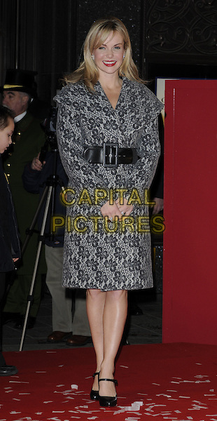 AMANDA HOLDEN.opens Harrods Winter Sale, wearing a wool coat by Catherine Melandrino..Knightsbridge, London, England, UK,.26th December 2009..full length grey gray pattern print wrap black waist belt  collar mary janes shoes Christian louboutin .CAP/CAN.©Can Nguyen/Capital Pictures.