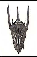 BNPS.co.uk (01202) 558833<br /> Picture: Julien's/BNPS<br /> <br /> ****Please use full byline****<br /> <br /> Sauron's helmet estimated to fetch &pound;37,500.<br /> <br /> Lord of the bling...<br /> <br /> Hobbit hero Frodo Baggins' ring and sword are among an incredible &pound;1.5 million archive of props from the blockbuster Lord of the Rings films that has emerged for sale.<br /> <br /> Dozens of the smash hit trilogy's most iconic costumes and props are up for grabs including Gandalf's staff, Sauron's helmet and Gimli's battle axe.<br /> <br /> Fans of the films, adapted from the 1954 book by British author J.R.R. Tolkein, can also get their hands on prosthetic hobbit ears and feet.<br /> <br /> Amazingly the props have been compiled by a Lord of the Rings enthusiast who has spent more than 10 years scouring the world for authentic memorabilia.<br /> <br /> They are being sold by Julien's Auctions in Los Angeles on December 5.