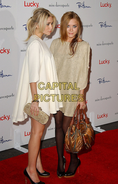 ASHLEY OLSEN & MARY KATE OLSEN.The Miss Davenporte trunk show hosted by Lucky Magazine held at Ron Herman in Beverly Hills, California  .November 17th, 2005.Ref: DVS.full length twins sisters siblings family white beige dress metallic bag purse gold clutch same shoes matching.www.capitalpictures.com.sales@capitalpictures.com.Supplied By Capital PIctures