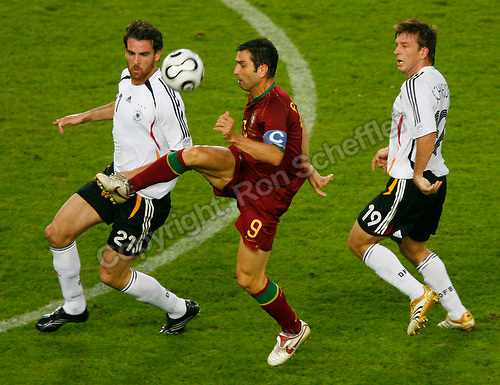 Jul 8, 2006; Stuttgart, GERMANY; Portugal forward (9) Pauleta plays the ball against Germany defender (21) Christoph Metzelder and midfielder (19) Bernd Schneider during first half play in the runner-up match to decide third place in the 2006 FIFA World Cup at Gottlieb-Daimler-Stadion, Stuttgart. Mandatory Credit: Ron Scheffler-US PRESSWIRE Copyright © Ron Scheffler