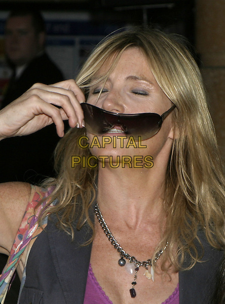 "MICHELLE COLLINS.""Herbie Fully Loaded"" Premiere,.Leicester Square, London,.28th July 2005.portrait headshot purple top sunglasses.www.capitalpictures.com.sales@capitalpictures.com.© Capital Pictures."