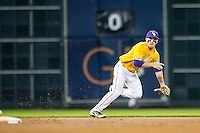 LSU Tigers shortstop Alex Bregman (8) tracks a ground ball during the Houston College Classic against the Nebraska Cornhuskers on March 8, 2015 at Minute Maid Park in Houston, Texas. LSU defeated Nebraska 4-2. (Andrew Woolley/Four Seam Images)