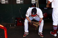 Mike O'Neill (11) of the Springfield Cardinals takes a moment to himself in the dugout prior to a game against the Tulsa Drillers at Hammons Field on May 4, 2014 in Springfield, Missouri. (David Welker/Four Seam Images)