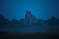 Wiveton, Norfolk, England, 09/08/2009..Mist and Wiveton church before dawn.