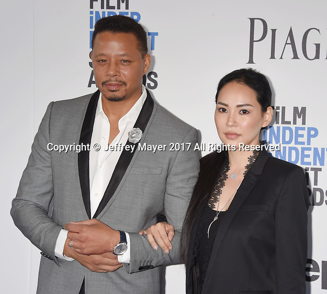 SANTA MONICA, CA - FEBRUARY 25: Actor Terrence Howard (L) and Miranda Pak attend the 2017 Film Independent Spirit Awards at the Santa Monica Pier on February 25, 2017 in Santa Monica, California.