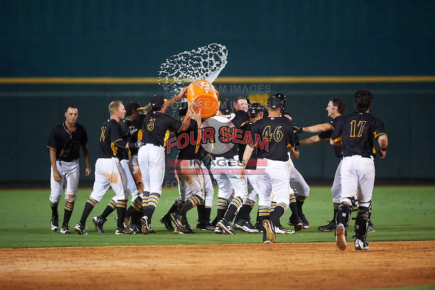 Bradenton Marauders Kevin Kramer (14) is mobbed by teammates and has a bucket of water thrown his direction after a walk off hit during a game against the Palm Beach Cardinals on August 8, 2016 at McKechnie Field in Bradenton, Florida.  Bradenton defeated Palm Beach 5-4.  Show are Tomas Morales (27), Chase Simpson (10), Trace Tam Sing (3), Connor Joe (6), Austin Coley (19), Wyat Mathisen (27), Buddy Borden (46), Taylor Gushue (17).  (Mike Janes/Four Seam Images)
