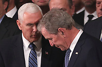 U.S. Vice President Mike Pence speaks with former President George W. Bush during memorial services for his father former President George H.W. Bush in the U.S. Capitol Rotunda in Washington, U.S., December 3, 2018. <br /> CAP/MPI/RS<br /> &copy;RS/MPI/Capital Pictures