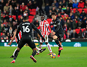 2nd December 2017, bet365 Stadium, Stoke-on-Trent, England; EPL Premier League football, Stoke City versus Swansea City;  Ki Sung-Yueng of Swansea City passes the ball forward to Martin Olsson
