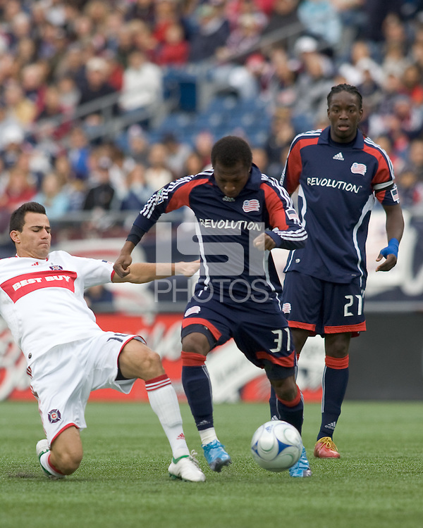 Chicago Fire midfielder Marco Pappa (16) tackles New England Revolution midfielder Sainey Nyassi (31). The New England Revolution out scored the Chicago Fire, 2-1, in Game 1 of the Eastern Conference Semifinal Series at Gillette Stadium on November 1, 2009.