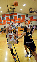 Westside Eagle Observer/MIKE ECKELS<br /> <br /> Reese Hamilton (24) puts up an off-balance hook shot over the head of Lady Tiger Emma Vance (4) late in the third quarter of the Gravette-Prairie Grove conference contest in the competition gym Jan. 14.
