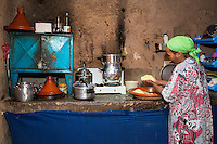 Morocco.  Woman Preparing Couscous in her Kitchen, Ait Benhaddou Ksar, a World Heritage Site.  Mixed Ethnicity:  Arab Father, Berber Mother.