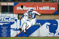 Jimmy Herron (30) and Griffin Conine (9) of the Duke Blue Devils celebrate against the Virginia Cavaliers in Game Seven of the 2017 ACC Baseball Championship at Louisville Slugger Field on May 25, 2017 in Louisville, Kentucky. The Blue Devils defeated the Cavaliers 4-3. (Brian Westerholt/Four Seam Images)