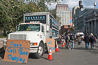 New York, NY -  2 November 2012 Guardian Data Destruction's Mobile IT Lab offers free cell phone charging and At&T Connectivity to residents of  Lower Manhattan in the aftermath of Hurricane Sandy.