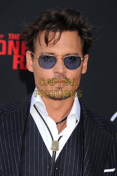 Johnny Depp<br /> &quot;The Lone Ranger&quot; World Premiere held at Disney's California Adventure Park,  Anaheim, California, USA, 22nd June 2013.<br /> portrait headshot sunglasses pinstripe white shirt blue tinted facial hair goatee beard moustache mustache western bolo tie navy blue <br /> CAP/ADM/BP<br /> &copy;Byron Purvis/AdMedia/Capital Pictures