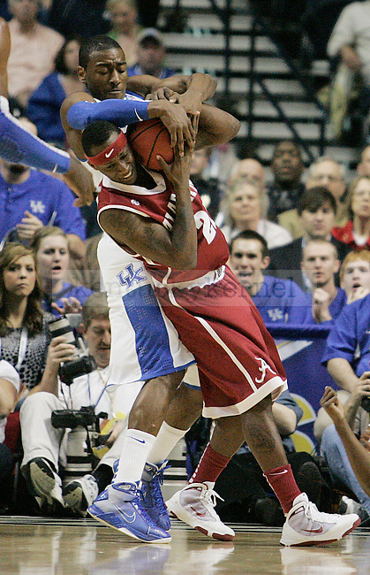 Freshman guard John Wall fights Senario Hillman for possession of the ball during the first half of the UK mens basketball team's 73-67 win over Alabama in the quarterfinals of the SEC tournament at the Sommet Center Friday, March 12, 2010. Photo by Britney McIntosh | Staff