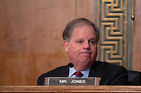 United States Senator Doug Jones (Democrat of Alabama) listens as Chair of the Federal Reserve Jerome Powell testifies before the U.S. Senate Committee on Banking, Housing, and Urban Affairs at the United States Capitol in Washington D.C., U.S. on Wednesday, February 12, 2020.  <br /> <br /> Credit: Stefani Reynolds / CNP/AdMedia