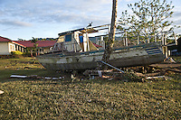A boat lies in the school grounds of the abandoned Poutasi village 24 hours the disaster. More than 170 people died when a tsunami triggered by an 8.3 magnitude earthquake hit Samoa and neighbouring Pacific islands on 29/09/2009. Samoa (formerly known as Western Samoa)..