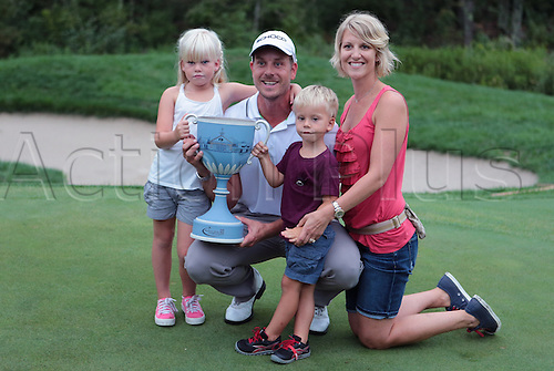 02.09.2013. Boston, Mass, USA.  Henrik Stenson poses with his family, Lisa, Karl and wife Emma after winning the Deutsche Bank Championship at TPC Boston, Norton, MA on September 2, 2013.