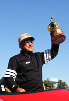 Sept. 6, 2010; Clermont, IN, USA; NHRA stock driver Tim Bishop celebrates after winning the U.S. Nationals at O'Reilly Raceway Park at Indianapolis. Mandatory Credit: Mark J. Rebilas-
