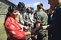 France 1989  <br /> In the military camp of Lastic, the arrival of Iraqi Kurdish immigrants shaking hands with French soldiers <br /> France 1989<br /> L'arrivee au camp militaire de Lastic des immigrants kurdes irakien, adieux des militaires francais