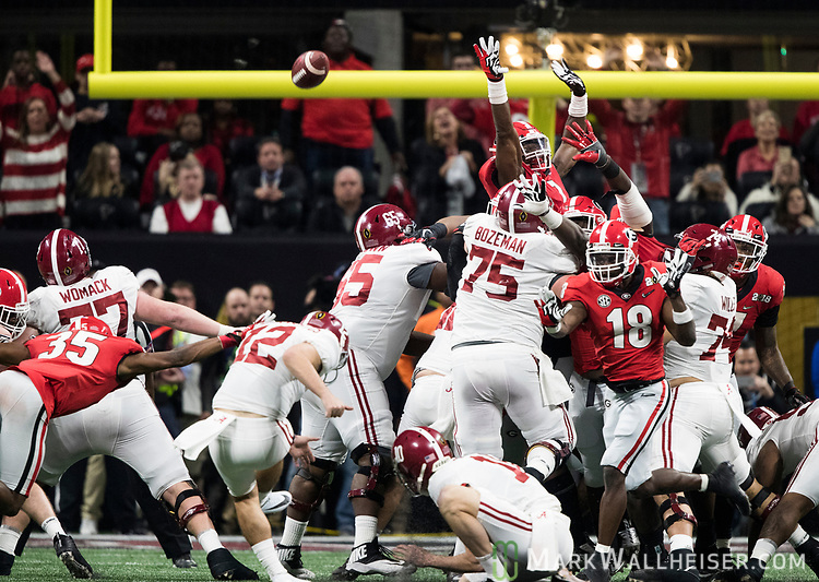 Alabama Crimson Tide place kicker Andy Pappanastos (12)  misses a field goal with no time left in regulation which forced the game into overtime of the NCAA College Football Playoff National Championship against the Georgia Bulldogs at Mercedes-Benz Stadium on January 8, 2018 in Atlanta. Photo by Mark Wallheiser/UPI
