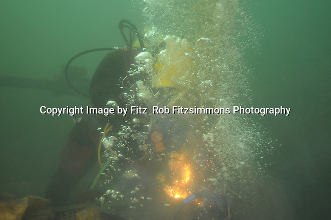 Minnesota Commercial Diver Training student cutting steel underwater