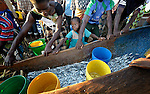 A boy is among those pulling a fishing boat ashore in Karonga, a town in northern Malawi. Fish from Lake Malawi, which is bordered by Malawi, Tanzania and Mozambique, provide an important part of people's diet in this area.