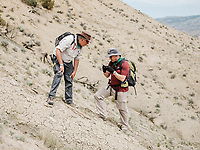 Head of Earth Sciences Department at the Natural History Museum and Professor Richard Herrington and Senior Curator for Invertebrate Paleontology Tim Ewin at the Jurassic Mile dinosaur dig site in the Big Horn Basin in Wyoming, July 2, 2019. The dig is led by Phillip L. Manning, a paleontologist at the University of Manchester in England.<br />  <br /> Photo by Matt Nager