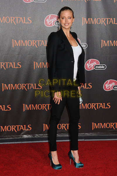 "Estella Warren.""Immortals"" World Premiere held at Nokia Theatre LA Live, Los Angeles, California, USA..November 7th, 2011.full length blazer jacket top clutch bag silver black white leggings trousers blue teal shoes .CAP/ADM/BP.©Byron Purvis/AdMedia/Capital Pictures."