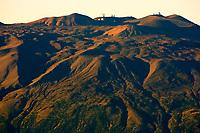 Mauna Kea volcano at sunset viewed from the 11,000 foot elevation of Mauna Loa volcano the Big Island of Hawaii