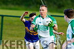 Paud Costello, Ballyduff slaloming his way out of defence being chased by TJ O'Connor of Cordal when the sides met last Saturday evening in Ballyduff.