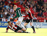 John Lundstram of Sheffield Utd tackles Ryan Woods of Brentford during the English Championship League match at Bramall Lane Stadium, Sheffield. Picture date: August 5th 2017. Pic credit should read: Simon Bellis/Sportimage