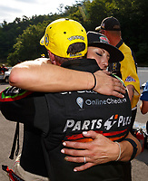 Jun 18, 2017; Bristol, TN, USA; NHRA top fuel driver Clay Millican (left) is congratulated by runner up Leah Pritchett after winning the Thunder Valley Nationals at Bristol Dragway. Mandatory Credit: Mark J. Rebilas-USA TODAY Sports
