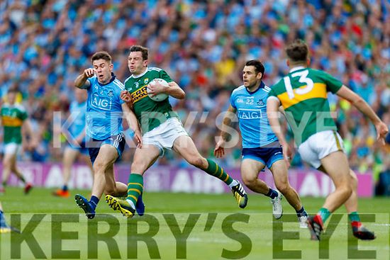 David Byrne, Dublin in action against David Moran, Kerry during the GAA Football All-Ireland Senior Championship Final match between Kerry and Dublin at Croke Park in Dublin on Sunday.
