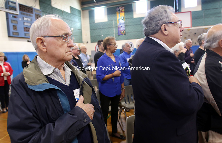 TORRINGTON CT. 14 November 2016-110816SV04-From left, Joe Barbieri and Sam Slaiby, both Army veterans from Torrington stand for the National Anthem during the annual Veterans Day celebration event at Vogel-Wetmore School in Torrington Monday. Over 40 veterans attended. <br /> Steven Valenti Republican-American