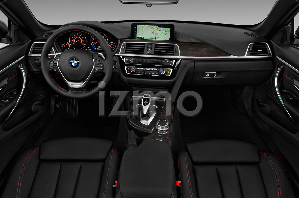 Stock photo of straight dashboard view of a 2018 BMW 4 Series 430i 2 Door Convertible