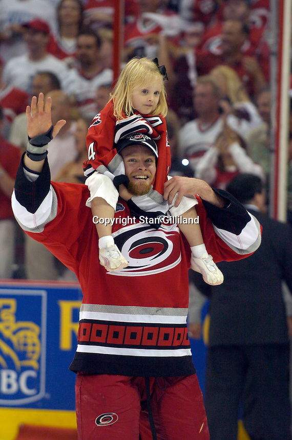 The Carolina Hurricanes beat the Edmonton Oilers 3-1 in game seven to take the Stanley Cup at the RBC Center in Raleigh, NC Monday, June 19, 2006. Here Kevyn Adams carries his daughter around the ice just before the Stanley Cup was brought onto the ice.