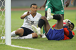 13 August 2008: Charlie Davies (USA) (9) and Ambruse Vanzekin (NGA) (right) end up on the ground following a play in the Nigeria penalty area.  The men's Olympic team of Nigeria defeated the men's Olympic soccer team of the United States 2-1 at Beijing Workers' Stadium in Beijing, China in a Group B round-robin match in the Men's Olympic Football competition.