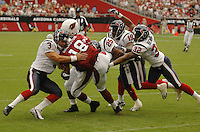 Aug 18, 2007; Glendale, AZ, USA; Arizona Cardinals wide receiver Steve Breaston (18) is tackled by Houston Texans kicker Kris Brown (3), cornerback Dexter Wynn (25), wide receiver Charlie Adams (19) and cornerback Fred Bennett (32) at University of Phoenix Stadium. Mandatory Credit: Mark J. Rebilas-US PRESSWIRE Copyright © 2007 Mark J. Rebilas