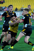 Ngani Laumape tries to tackle Damien McKenzie during the Super Rugby quarterfinal match between the Hurricanes and Chiefs at Westpac Stadium in Wellington, New Zealand on Friday, 20 July 2018. Photo: Dave Lintott / lintottphoto.co.nz