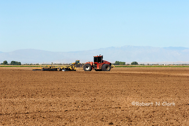 Discing and levelling a field after crops were harvested